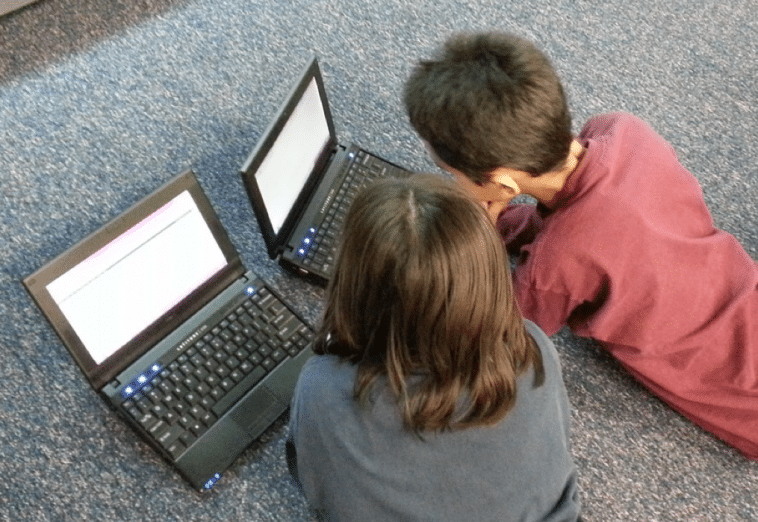 Children viewing laptops